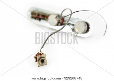 Old electric guitar electronics. Volume, Tone and Pick up. selector assembly isolated on white.