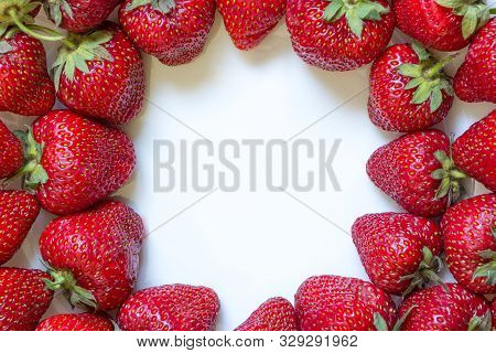 Frame From Fresh Strawberry With White Copy Space Inside. Top View, Flat Lay, Close-up. Place For Cu