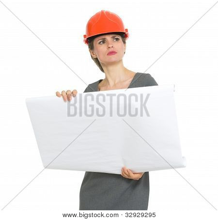 Authoritative Architect Woman With Flipchart Looking Into Distan