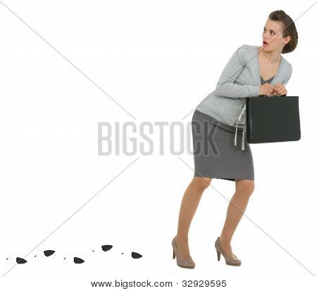 Sneaking Business Woman With Briefcase Leaving Trace