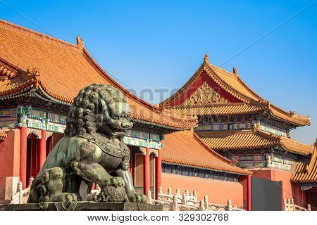Chinese Guardian Lion Or Shishi Statue From Ming Dynasty Era, At The Entrance To The Palace In The F