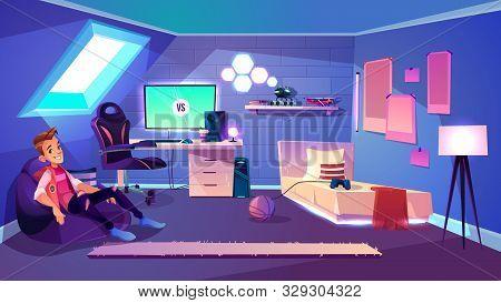 Teenage Boy Sitting In Comfortable Bag Armchair In His Cozy Room On House Attic Cartoon . Computer G