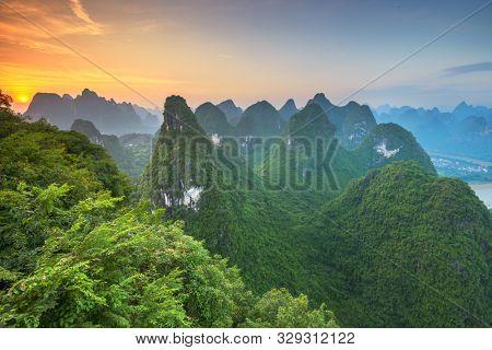Karst Mountains of Xingping, Guilin, China.Karst Mountains of Xingping, Guilin, China at dawn.
