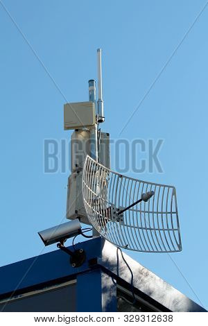 Tv Antennas With Transmitters And Closed Circuit Tv Cctv Security Camera Densely Mounted On Single P