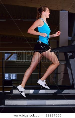beautiful woman is running on the treadmill