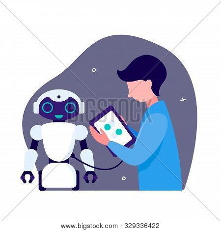 Design Of Robots And Robotic Systems. The Guy Loads The Software In The Android Robot. Autonomous Ro