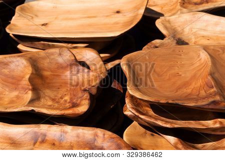 A Group Of Wooden Plates Made Of Birch And Handmade Close-up.