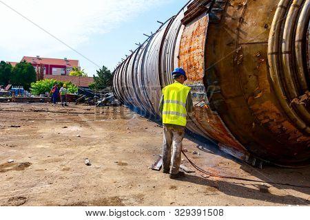 Zrenjanin, Vojvodina, Serbia - June 08, 2018: Worker Is Cutting Manually Old Metal Construction Usin