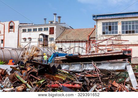 Zrenjanin, Vojvodina, Serbia - June 08, 2018: Piled Up Scrap Metal, Old Profiles And Equipment, Part