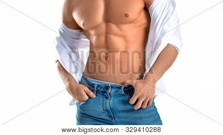 Man In Blue Jeans With Perfect Abs. Isolated On White Background.