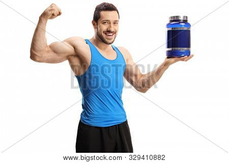 Young bodybuilder holding a pack of protein powder and flexing bicep muscle isolated on white background