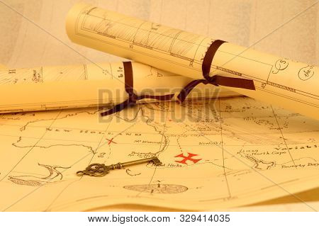 An Old Fashioned Map And Key Outlining A Path To Reveal Buried Treasure At The X Marking The Spot.