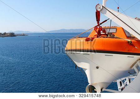 White and orange lifeboat in the aegean sea poster