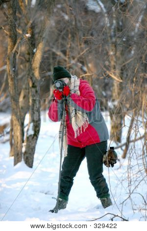 Female Taking Photos On Snowy Day