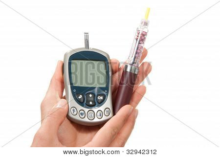 Hands With Syringe Pen Injector And Glucometer