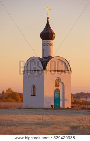 The Old Chapel Of The Sovereign Icon Of The Mother Of God Close-up In October Dawn. The Surroundings