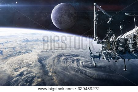 Iss In Open Space Against The Background Of The Earths Landscape And The Moon. Solar System. Science
