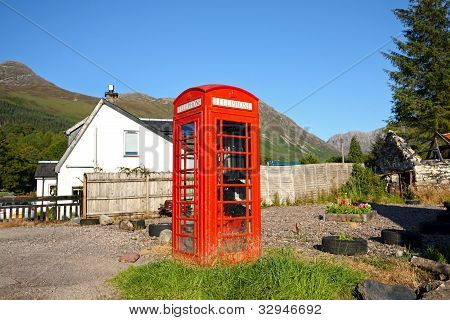 Old, British, red phonebox in the Scottish village.