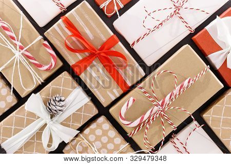 New Year Composition. Christmas Background With Red, Craft, White Wrapped Gifts Boxes With Colored R