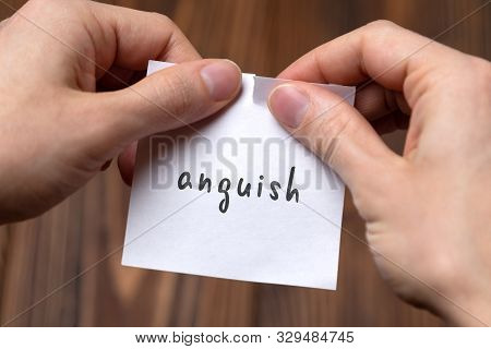 Dealing With Problem Concept. Hands Tearing Paper Sheet With Inscription Anguish.