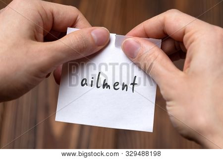 Dealing With Problem Concept. Hands Tearing Paper Sheet With Inscription Ailment.