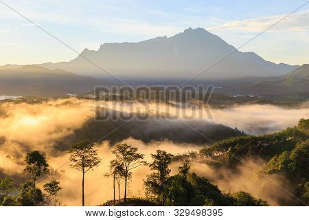 Amazing Beautiful Nature Landscape View Of Sunrise With  Nature Misty Foggy And Mount Kinabalu, Saba