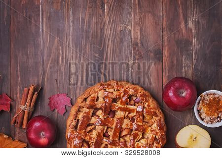 Creative Autumn Compositionwith Homemade Apple Pie, Red Leaves And Aplles On Wooden Table