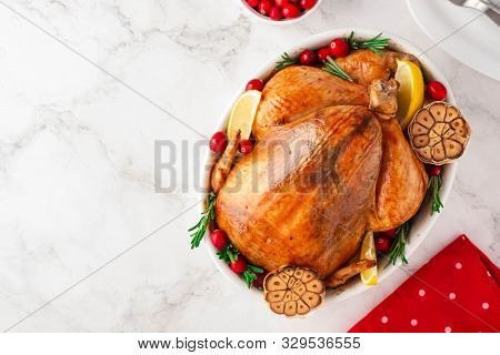 Christmas Chicken In A White Ceramic Form On A Light Background. Christmas Atmosphere.