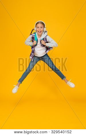 Energetic And Enthusiastic. Energized Small Girl Jump High With Energetic Power. Active Kid Back To