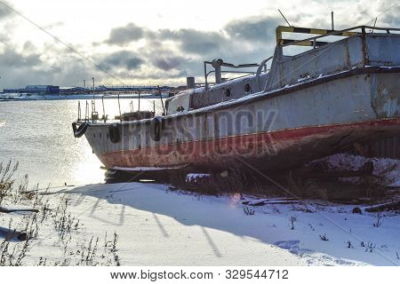 Old Abandoned Wrecked Fishing Boat At Ship Or Boat Graveyard. Lots Of Different Dry Docked, Destroye