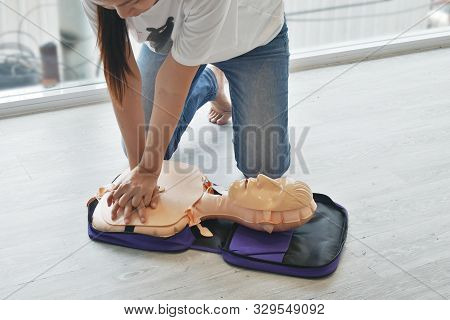 Cpr Training. Close-up Of Trainee's Hand Pump On Chest Of Dummy On Cpr First Aid Training Course For