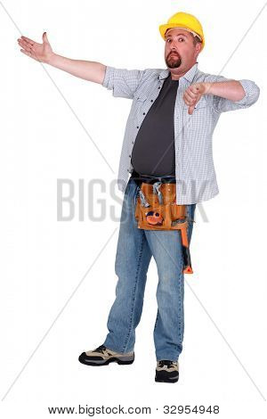 Tradesman pointing to an object and giving the thumb's down