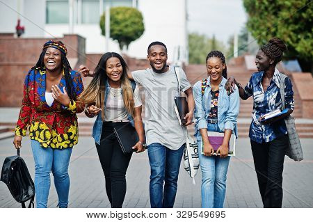 Group Of Five African College Students Spending Time Together On Campus At University Yard. Black Af