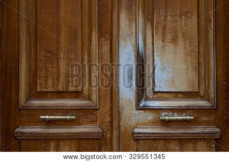 Weathered Shabby Natural Wood Patterned Double Door With Shiny Vintage Metal Handles. Architectural