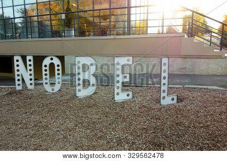 Kharkiv, Ukraine, September 2019 Letters Installation Of Text Nobel In Front Of Modern Urban Buildin