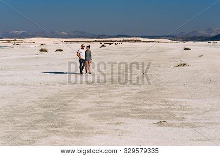 A Loving Couple Walks Along The Coast Of Lake Salda In Turkey. Couple Travels In Turkey. Lake Salda