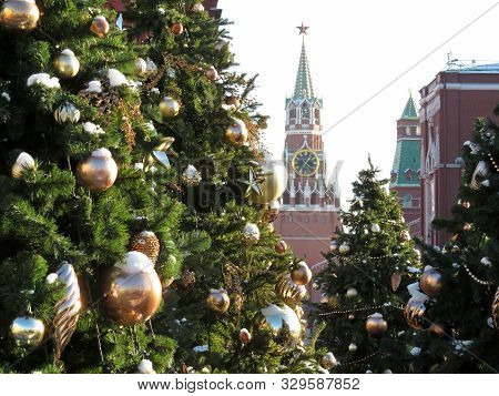 Moscow Kremlin and Christmas decorations on Red square. New Year tree in Russia, view of the Spasskaya tower and Kremlin chimes poster