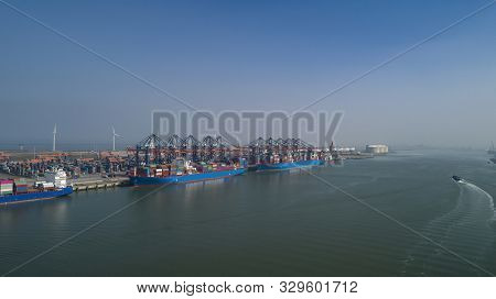 Aerial View Of Container Terminal In The Harbor Maasvlakte, Netherlands. A Large Containership From