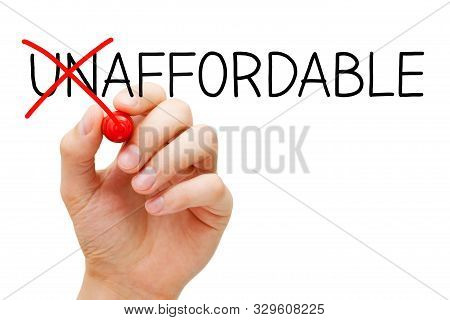 Hand Writing A Concept Changing The Word Unaffordable Into Affordable With Red Marker Isolated On Wh