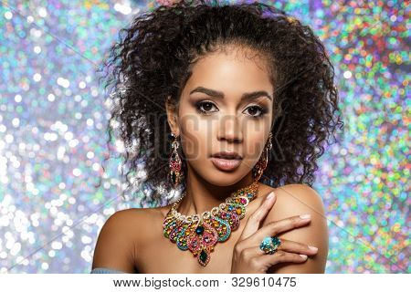 Beautiful model girl with set of Jewelry. Luxury girl in shine jewellry: Eearrings, Necklace, and Ring. Woman in jewelry from Gold, Precious Stones, Siamonds. Beauty and accessories.