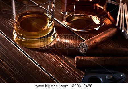 Still Life With Glass And Bottle Of Alcohol, Whiskey Or Brandy Or Rum. Three Cuban Cigars, Cutter An
