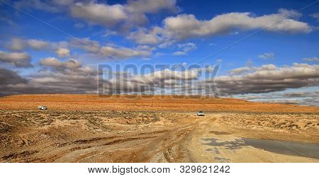 Road At Sunset Crossing The Karakum Desert In Turkmenistan.