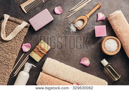 Flat Lay A Set Of Various Bath And Spa Accessories. Terry Towel, Soap, Comb, Oil, Shampoo, Loofah Wa