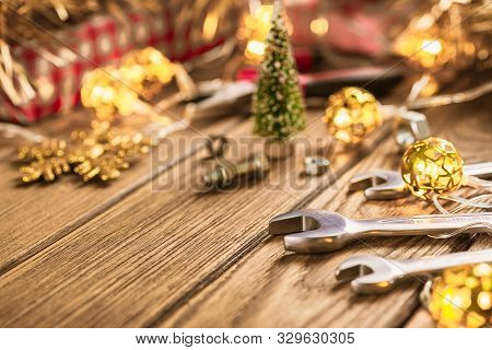 Handy Tools On Christmas Time Background Concept. Wrenches And Handy Tools With Christmas Ornament D