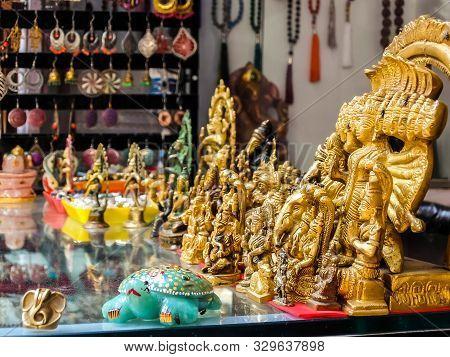 Rishikesh, India - Circa April 2018. Small Bronze Statuettes On The Street Market In Rishikesh.