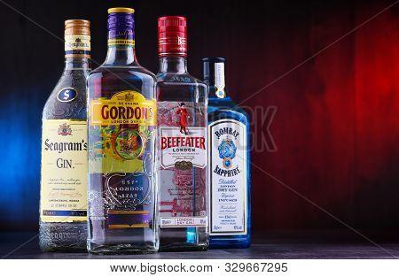 Four Bottles Of Popular Gin Brands