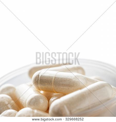 White Medical Capsules Of Glucosamine Chondroitin, Healthy Supplement Pills In The Plastic Spoon Iso