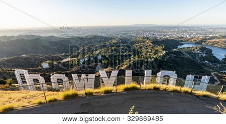 Los Angeles, California, USA - October 21, 2019:  Early morning panorama cityscape view from the back of the Hollywood Sign in popular Griffith Park.