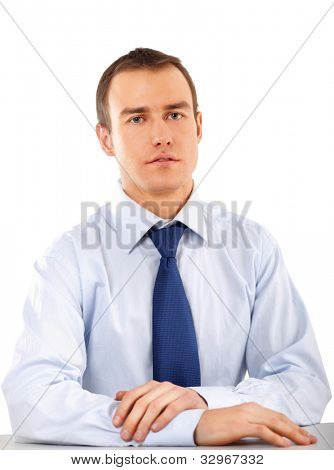 The businessman sitting on the desk in office