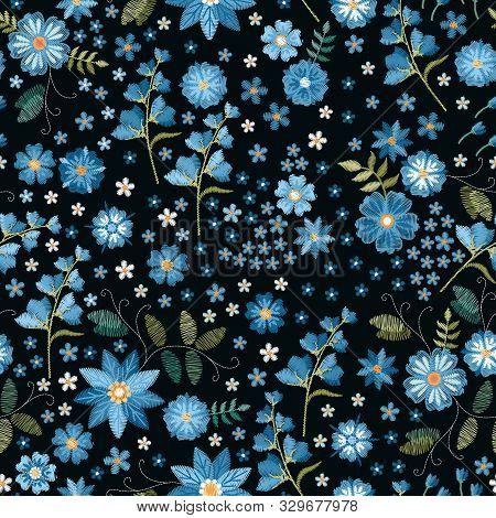 Floral Fancywork. Embroidered  Seamless Pattern. Embroidery Blue Flowers On Black Background. Print